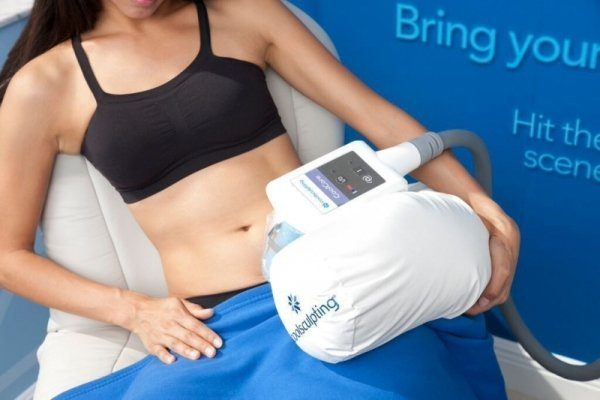 Photo showing a woman undergoing coolsculpting procedure