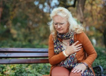 Elderly woman experiencing heart attack